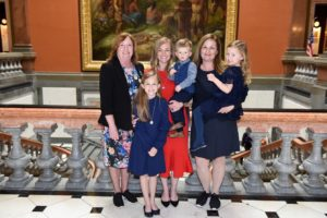 Pictured: State Rep. Monica Bristow, D-Alton, (left) and state Sen. Rachelle Crowe, D-Glen Carbon, (center), with Capt. Jake Ringering's wife, Alison, (center) and their children, Nora, Elaina, and Logan, after the presentation of the House Resolution honoring Godfrey Fire Captain Jake Ringering.