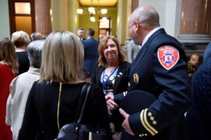 Pictured: State Rep. Monica Bristow, D-Alton, was joined by the family and local firefighters on Wednesday in Springfield to honor Godfrey Fire Captain Jake Ringering, who lost his life in the line of duty. Bristow is shown shaking hands with Captain Jedediah Downs of the East Alton Fire Department and brother-in-law of Captain Ringering.