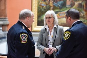 State Rep. Mary Edly-Allen, D-Libertyville, discussing solutions to prevent prescription drug abuse with Lake Zurich Police Chief Steve Husak (Left) and Vernon Hills Police Chief Pat Kreis (right).
