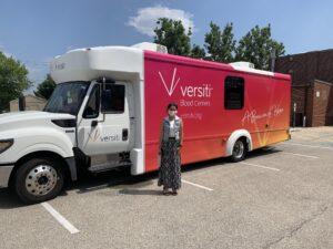 Pictured: State Representative Barbara Hernandez outside the Versiti Mobile Blood Donation Bus.