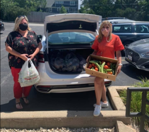 PICTURED: State Rep. Terra Costa Howard accepts fresh produce donations to benefit Glen Ellyn-area food pantries from Illinois Farm Bureau Manager Lindsay McQueen.